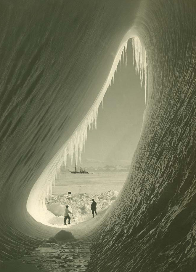 Griffith Taylor and Silas Wright in an ice cave, framing Terra Nova in the background